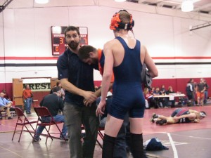 Coach Powell instructing Colin after a win